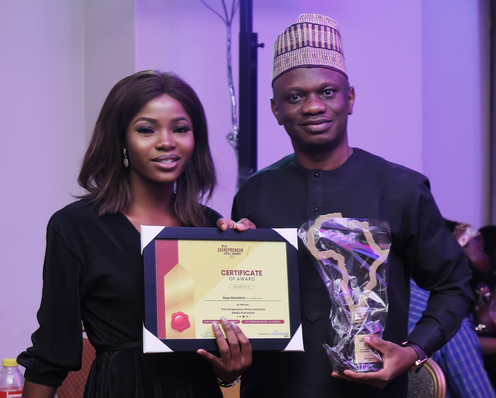 L-R Mercy Alao, Community Manager, MSME Africa and Seye Olurotimi, Founder, MSME Africa posing with the Entrepreneurs Africa Award for Media Innovation 2021