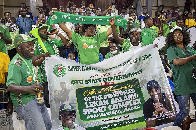 Photo shows the Super Eagles Supporters Club at the Commissioning of the Remodeled Lekan Salami Stadium, Adamasingba, Ibadan, sponsored by Rite Foods Limited, makers of Bigi carbonated soft drinks, Bigi premium water and Fearless energy drink.